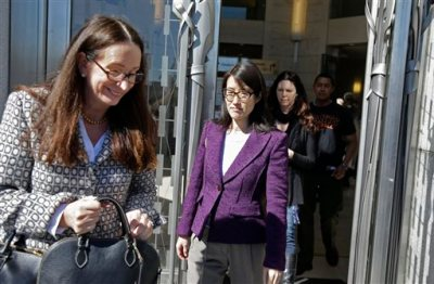 Ellen Pao, center, with her attorney, Therese Lawless, left, leaves the Civic Center Courthouse during a lunch break in her trial Tuesday, Feb. 24, 2015, in San Francisco. Pau, the current interim chief of the news and social media site Reddit, is seeking $16 milion in her suit against prominent Silicon Valley venture capital firm Kleiner Perkins Caulfield and Byers, alleging she was sexually harassed by male officials. (AP Photo/Eric Risberg)