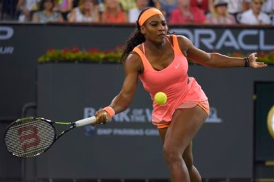 Serena Williams returns to Monica Niculescu, of Romania, in a match at the BNP Paribas Open tennis tournament, Friday, March 13, 2015, in Indian Wells, Calif. (AP Photo/Mark J. Terrill)