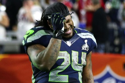 In this Sunday, Feb. 1, 2015, photo, Seattle Seahawks running back Marshawn Lynch reacts to the interception that sealed the Seahawks 28-24 loss to the New England Patriots in the NFL Super Bowl XLIX football game in Glendale, Ariz. (AP Photo/The Seattle Times, Bettina Hansen)