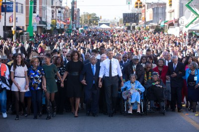 The Obama family join hands as they begin the march with the foot soldiers across the Edmund Pettus Bridge. (Official White House Photo by Lawrence Jackson)
