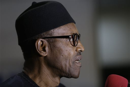 Nigerian former Gen. Muhammadu Buhari speaks to journalists in Abuja, Nigeria, Wednesday, April 1, 2015. Nigerian President Goodluck Jonathan conceded defeat to Buhari, a 72-year-old former military dictator, who was elected in a historic transfer of power following the nation's most hotly contested election ever. (AP Photo/Sunday Alamba)