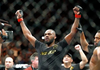 This Jan. 3, 2015, file photo shows Jon Jones celebrates after defeating Daniel Cormier during their light heavyweight title mixed martial arts bout in Las Vegas. Albuquerque police were searching for UFC light heavyweight champion Jones on Sunday night, April 26, 2015, in connection with a hit-and-run accident. Police spokesman Officer Simon Drobik said Jones is wanted for questioning about the crash, which occurred earlier in the day. No charges have been filed, but a pregnant woman driving another vehicle was hospitalized with minor injuries. (AP Photo/John Locher, File)