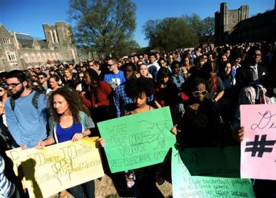Duke students from front left to right, Michaela Stith, Ashley Croker-Benn and Jasmine Roddey rally during a university-wide forum outside the Duke Chapel on campus Wednesday, April 1, 2015, in Durham, N.C. Duke officials said Wednesday that they are trying to find out who hung a noose outside a building that houses several offices, including those focused on diversity. (AP Photo/The Herald-Sun, Christine T. Nguyen) (AP/The Herald-Sun, Christine T. Nguyen)