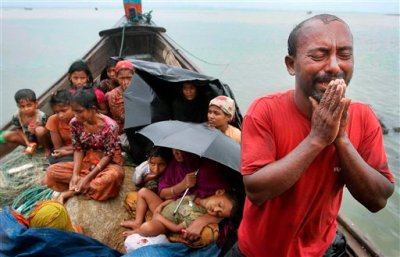 In this June 13, 2012, file photo, a Rohingya Muslim man who fled Myanmar to Bangladesh to escape religious violence, cries as he pleads from a boat after he and others were intercepted by Bangladeshi border authorities in Taknaf, Bangladesh. Two recent shipwrecks in the Mediterranean Sea believed to have taken the lives of as many as 1,300 asylum seekers and migrants has highlighted the escalating flow of people fleeing persecution, war and economic difficulties in their homelands. (AP Photo/Anurup Titu, File)