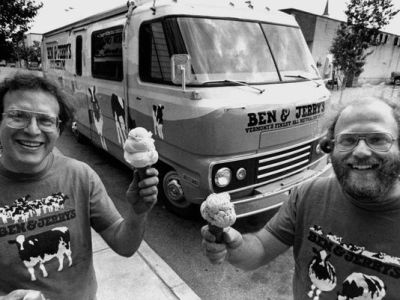 "Jerry Greenfield, left, and Ben Cohen, founders of Ben & Jerry's Homemade Inc., stand in front of their ""Scoopmobile"" in Burlington, Vt. in 1986 . The founders of Ben & Jerry's Homemade Inc. say the company would not have existed without government resources that would be threatened if Congress repeals the estate tax. (Toby Talbot/AP Photo)"