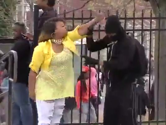 In an image taken from video, a woman later identified as Toya Graham wrangles her son after she found out that he was rioting in Baltimore on Monday. (Courtesy of YouTube)