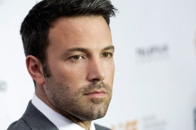 """Actor and director Ben Affleck poses for a photograph on the red carpet at the gala for the new movie """"Argo"""" during the 37th annual Toronto International Film Festival in Toronto on Friday, Sept. 7, 2012. (AP Photo/The Canadian Press, Nathan Denette)"""