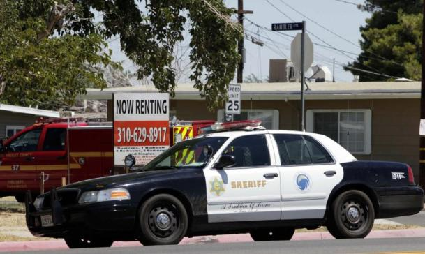 The Los Angeles County Sheriff's Department agreed to settle after it was the focus of a federal probe over allegations that deputies discriminated against blacks and Hispanics in two high desert cities, officials announced. (AP Photo/Nick Ut)