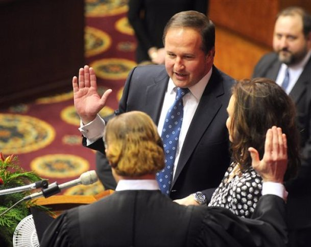 """In this Jan. 7, 2015, file photo, John J. Diehl Jr., center, is sworn in as the Speaker Pro Tem of the House of Representatives during the opening of the Missouri legislature in Jefferson City, Mo. Diehl apologized Wednesday, May 13, 2015, for his """"poor judgment"""" following a newspaper report that he had exchanged sexually charged text messages with a college student who was serving as a Capitol intern. (Don Shrubshell/The Columbia Daily Tribune via AP, File)"""