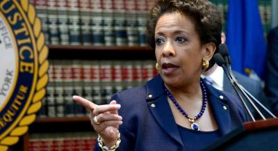 U.S. General Attorney Loretta Lynch holds a press conference to announce law enforcement action against FIFA officials in a 47-count indictment at the US. Attorney's Office in Brooklyn, NY, on May 27, 2015. Nine FIFA Officials and five corporate executives charged with racketeering conspiracy, corruption and money laundering. (Anthony Behar/AP Photo)