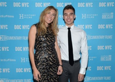 "In this Nov. 14, 2014 file photo, director Amy Berg poses with Evan Henzi from the film, at the world premiere of ""An Open Secret"" during DOC NYC at the SVA Theater, New York. Documentary 'An Open Secret' by Amy Berg, screens at the 68th international Cannes film festival. (Photo by Evan Agostini/Invision/AP, File)"
