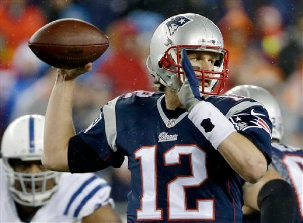 In this Jan. 18, 2015, file photo, New England Patriots quarterback Tom Brady looks to pass during the first half of the NFL football AFC Championship game against the Indianapolis Colts  in Foxborough, Mass. The NFL suspended Brady for the first four games on Monday, May 11, 2015, for his role in a scheme to deflate footballs used in the AFC title game. (AP Photo/Matt Slocum, File)