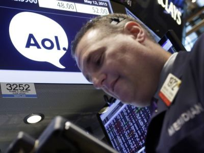 Trader Jonathan Corpina works at the post that handles AOL on the floor of the New York Stock Exchange, Tuesday, May 12, 2015. (Richard Drew/AP Photo)