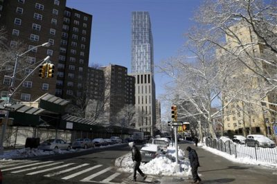 In this Feb. 3, 2015 file photo, a luxury rental building rises high above other buildings in the East Harlem section of New York.  High rents are worth it. At least that's the sentiment of apartment dwellers in New York, San Francisco and Washington, who say they're more satisfied living in those cities than do renters in far more affordable areas such as Milwaukee, Albuquerque and Detroit, according to a survey released Thursday, May 21, 2015 by Apartment List. (AP Photo/Seth Wenig, File)