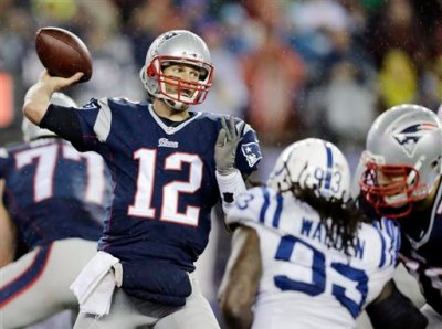 "In this Jan. 18, 2015, file photo, New England Patriots quarterback Tom Brady (12)  passes against the Indianapolis Colts during the second half of the NFL football AFC Championship game in Foxborough, Mass. An NFL investigation has found that New England Patriots employees likely deflated footballs and that quarterback Tom Brady was ""at least generally aware"" of the rules violations. The 243-page report released Wednesday, May 6, 2015, said league investigators found no evidence that coach Bill Belichick and team management knew of the practice. (AP Photo/Charles Krupa, File)"