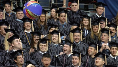 School of Business graduates toss a beach ball around during commencement exercises at the University of Connecticut in Storrs, Conn., Sunday, May 7, 2006. (AP Photo/Jessica Hill)