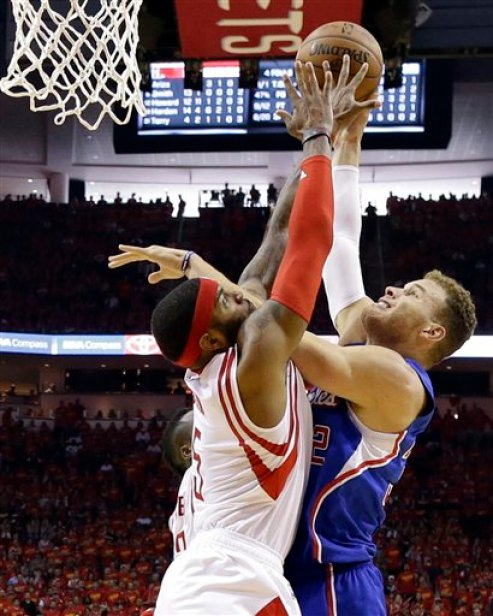 Houston Rockets forward Josh Smith (5) blocks a shot by Los Angeles Clippers forward Blake Griffin (32) during the second half in Game 7 of the NBA basketball Western Conference semifinals Sunday, May 17, 2015, in Houston. (AP Photo/David J. Phillip)