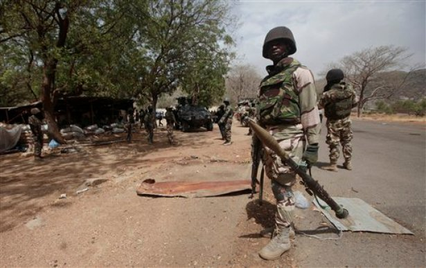 In this file photo taken Wednesday, April 8, 2015, Nigerian Soldiers man a check point in Gwoza, Nigeria, a town newly liberated from Boko Haram.  (AP Photo/Lekan Oyekanmi,File)