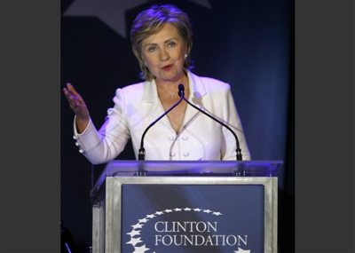 FILE - In this Oct. 28, 2006 file photo, then-Sen. Hillary Rodham Clinton, D-N.Y., speaks at a benefit gala for the Clinton Foundation at the American Museum of Natural History in New York.  Millions of dollars in foreign money sloshing around a presidential candidate, even in the name of helping the world's poor, is bound to spill over into controversy. Doubly so when it comes to the Clintons, America's two-for-the-price-of-one political family. (AP Photo/Jason DeCrow, File)