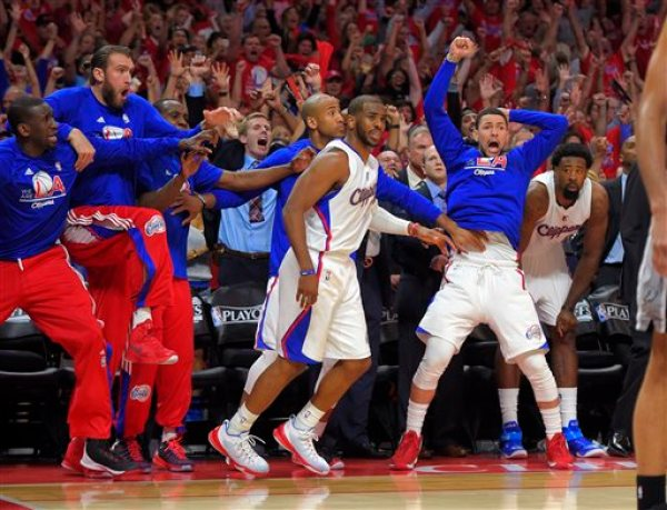 Members of the Los Angeles Clippers bench celebrates after guard Chris Paul, center, hit a basket with a second left in second half of Game 7 in a first-round NBA basketball playoff series against the San Antonio Spurs, Saturday, May 2, 2015, in Los Angeles. The Clippers won 111-109. (AP Photo/Mark J. Terrill)