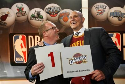 In this May 20, 2014, file photo, Cleveland Cavaliers general manager David Griffin, left, and minority owner Jeff Cohen celebrate after the Cavaliers won the top pick in the the NBA basketball draft lottery in New York. The 2015 NBA draft lottery will take place in New York on Tuesday, May 19, 2015. (AP Photo/Kathy Willens, File)
