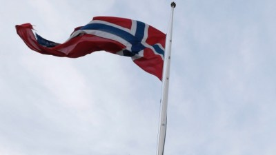 A Norwegian flag flies at half-mast in this Dec. 6, 2013 file photo. (AP/NTB scanpix, Cornelius Poppe)