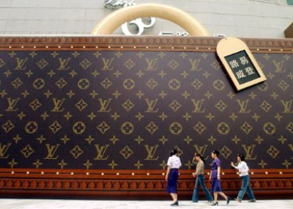 A giant Louis Vuitton trunk showcasing the brand's iconic LV monogram (AP Photo)