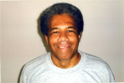 """This undated photo provided by the International Coalition to Free the Angola 3 shows Albert Woodfox. Prosecutors sought to keep Woodfox, the last of the """"Angola Three,"""" behind bars Tuesday, June 9, 2015, despite a federal judge's order to immediately release him after 43 years in isolation, a longer period in lockdown than any other living U.S. prisoner. Woodfox was one of several prisoners accused of killing Brent Miller, a 23-year-old guard at the Louisiana State Penitentiary, in Angola, La., in 1972. (Courtesy of International Coalition to Free the Angola 3 via AP)"""