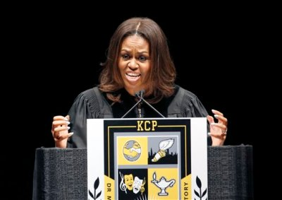 First lady Michelle Obama delivers the commencement address during graduation ceremonies for the Class of 2015 at Dr. Martin Luther King College Preparatory High School held on the campus of Chicago State University, Tuesday, June 9, 2015, in Chicago. King College Prep is the high school where Hadiya Pendleton would have graduated if she hadn't been shot and killed in a gang incident. (AP Photo/Christian K Lee)