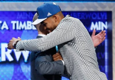 Karl-Anthony Towns, right, is greeted by NBA Commissioner Adam Silver after the Minnesota Timberwolves selected Towns, a Kentucky center, with the top pick in the NBA basketball draft, Thursday, June 25, 2015, in New York. (AP Photo/Kathy Willens)