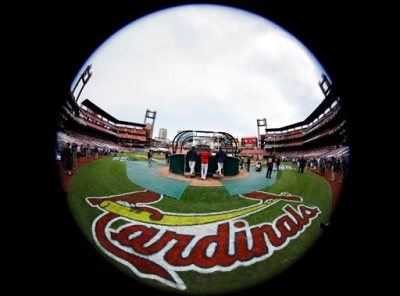 In this Oct. 28, 2015, file photo, taken with a fisheye lens, St. Louis Cardinals take batting practice before Game 5 of baseball's World Series against the Boston Red Sox in St. Louis. Federal law enforcement authorities are investigating whether the Cardinals illegally hacked into a computer database of the Houston Astros to obtain information on players, a person familiar with the situation said Tuesday, June 16, 2015, in an unusual case involving two former division rivals in Major League Baseball. (AP Photo/Matt Slocum, File)
