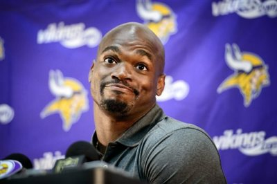 Vikings running back Adrian Peterson speaks at a news conference in Eden Prairie, Minn., Tuesday June 2, 2015.  Peterson practiced with the Vikings for the first time in nine months on Tuesday. (Glen Stubbe/Star Tribune via AP)