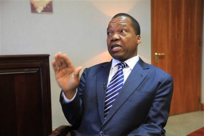 "Zimbabwe Reserve Bank Governor, John Mangudya, talks to the Associated Press in Harare, Zimbabwe, Monday, June, 15,  2015. The Zimbabwe central bank invited last week Zimbabweans still holding on to notes of the Zimbabwean dollar to  exchange them for U.S dollars starting Monday as part of a process to phase out  a currency that  has so many zero notes that ran into trillions. According to Mangudya  ""Zimbabweans are excited""  about the move, adding that the old notes will  be burnt and shredded, "" as is the practice globally."" (AP Photo/Tsvangirayi Mukwazhi)"