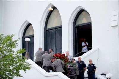 Pallbearers carry the casket of Sen. Clementa Pinckney, one of the nine killed in last week's shooting, into Emanuel AME Church for his wake, Thursday, June 25, 2015, in Charleston, S.C. The first funerals of some of those slain began Thursday at nearby churches with a viewing for Pinckney inside Emanuel on Thursday evening. President Barack Obama will deliver the eulogy at Pinckney's funeral Friday at a nearby college arena. (AP Photo/David Goldman)