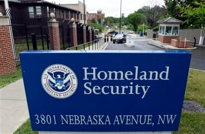 In this June 5, 2015, file photo, a gate leading to the Homeland Security Department headquarters in northwest Washington. Hackers stole personnel data and Social Security numbers for every federal employee, a government worker union said Thursday, June 11, 2015, charging that the cyberattack on U.S. employee data is far worse than the Obama administration has acknowledged. (AP Photo/Susan Walsh, File)