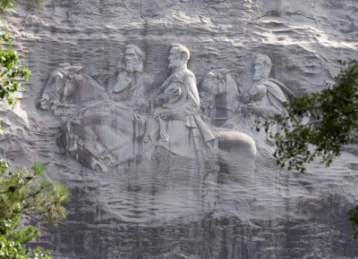 This photo shows a carving depicting confederates Stonewall Jackson, Robert E. Lee and Jefferson Davis, Tuesday, June 23, 2015, in Stone Mountain, Georgia. (AP Photo/John Bazemore)