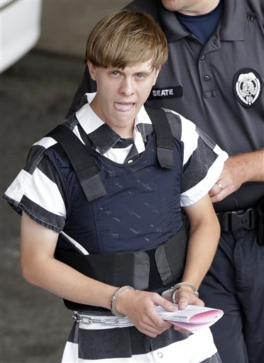 Charleston, S.C., shooting suspect Dylann Storm Roof is escorted from the Cleveland County Courthouse in Shelby, N.C., Thursday, June 18, 2015. Roof is a suspect in the shooting of several people Wednesday night at the historic The Emanuel African Methodist Episcopal Church in Charleston. The current brick Gothic revival edifice, completed in 1891 to replace an earlier building heavily damaged in an earthquake, was a mandatory stop for the likes of Booker T. Washington and the Rev. Martin Luther King Jr. Still, Emanuel was not just a church for the black community.(AP Photo/Chuck Burton)