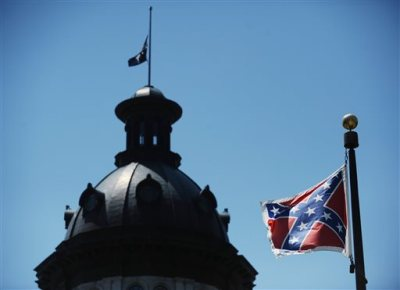 FILE - In a Friday, June 19, 2015 file photo, the Confederate flag flies near the South Carolina Statehouse, in Columbia, S.C. For 15 years, South Carolina lawmakers refused to consider removing the Confederate flag from Statehouse grounds, but opinions changed within five days of the massacre of nine people at Emanuel African Methodist Episcopal church in Charleston, as a growing tide of Republicans joined the call to remove the battle flag from a Confederate monument in front of the Statehouse and put it in a museum. (AP Photo/Rainier Ehrhardt, File)