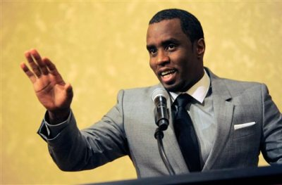 """In this July 26, 2013 file photo, Sean """"Diddy"""" Combs of the new network Revolt TV addresses reporters at the Beverly Hilton Hotel in Beverly Hills, Calif. Police say hip-hop music mogul Combs has been arrested on the campus of the University of California, Los Angeles. UCLA police spokeswoman Nancy Greenstein confirmed that Combs was taken into custody by campus officers on Monday, June 22, 2015. Greenstein did not immediately provide further details. (Photo by Chris Pizzello/Invision/AP, File)"""