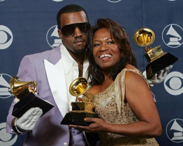 Kanye West and Donda West holding his three awards backstage at the 48th Annual Grammy Awards in 2006. (Reed Saxon/Associated Press)