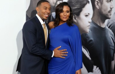 """Ludacris, left, and Eudoxie Agnan arrive at the premiere of """"Furious 7"""" at the TCL Chinese Theatre IMAX on Wednesday, April 1, in Los Angeles. (AP Photo/Matt Sayles)"""