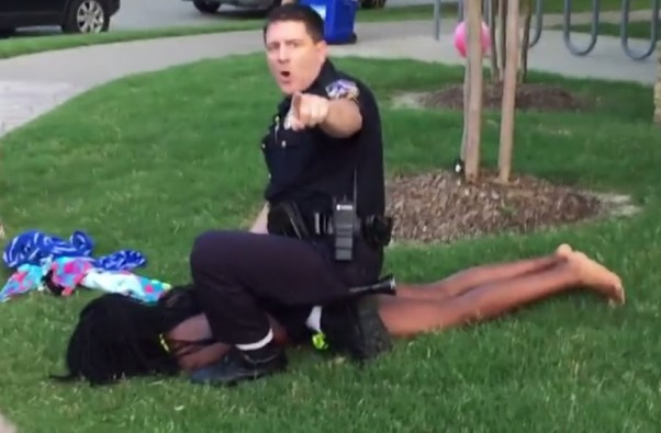 Cpl. Eric Becton forces Dajerria Becton, 15, to the ground after responding to a disturbance call. (Screengrab via Youtube)