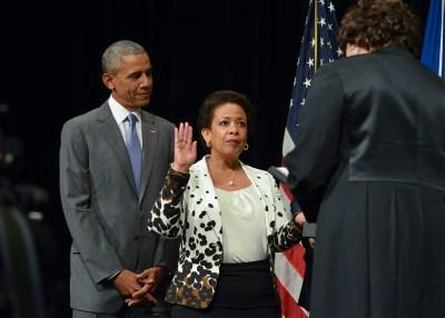 Loretta Lynch being sworn in by Associate Supreme Court Justice Sonia Sotomayor as President Obama looks on. (Freddie Allen/NNPA Photo)