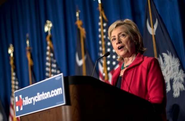 """In this July 23, 2015, photo, Democratic presidential hopeful Hillary Rodham Clinton speaks at a campaign event in Columbia, S.C. In her second pass at the presidency, Clinton has made discussing """"systemic racism"""" a hallmark of her campaign as she looks to connect with the black voters who helped propel President Barack Obama to the White House. At multiple campaign stops, she bemoaned """"mass incarceration,"""" an uneven economy, increasingly segregated public schools, and poisoned relationships between police and the black community. She praised South Carolina leaders, including Republican Gov. Nikki Haley, for removing the Confederate battle from statehouse grounds after a white gunman's June massacre of nine churchgoers at a historic black congregation in Charleston. But she warned that the act is symbolic. (AP Photo/Stephen B. Morton)"""