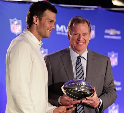 FILE - In this Feb. 2, 2015, file photo, New England Patriots quarterback Tom Brady, left, poses with NFL Commissioner Rodger Goodell during a news conference where Brady was presented the Super Bowl MVP  in Phoenix, Ariz. Brady's four-game suspension for his role in using underinflated footballs during the AFC championship game last season has been upheld by Commissioner Goodell. The league announced the decision Tuesday, July 28, 2015. (John Samora/The Arizona Republic via AP, File)