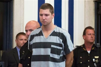 Former University of Cincinnati police officer Ray Tensing appears at Hamilton County Courthouse for his arraignment in the shooting death of motorist Samuel DuBose, Thursday, July 30, 2015, in Cincinnati. Tensing pleaded not guilty to charges of murder and involuntary manslaughter. (AP Photo/John Minchillo)
