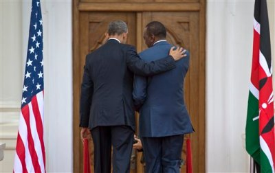 President Barack Obama, left, puts his arm on the shoulder of Kenya's President Uhuru Kenyatta, right, as the two leave after speaking to the media at State House in Nairobi, Kenya Saturday, July 25, 2015. (AP Photo/Ben Curtis)