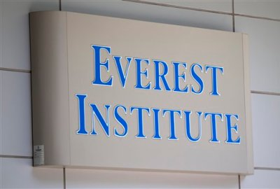 This July 8, 2014 file photo shows an Everest Institute sign on an office building in Silver Spring, Md. In the two decades since trade schools started popping up on U.S. stock exchanges to maximize profits, allegations of misconduct have been rampant. On July 1, 2015, new rules go into effect for any school with a career-training program. The Education Department estimates it loaned some $3.6 billion in the past five years to Corinthian students before the government forced it to sell or close its campuses. (AP Photo/Jose Luis Magana, File)