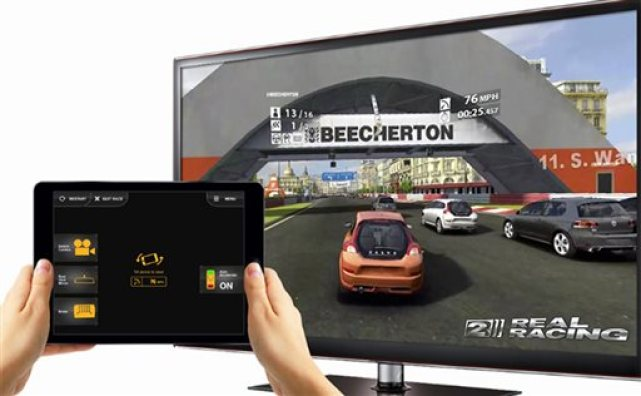 """This product image provided by Comcast shows game action from Electronic Arts' """"Real Racing 2"""" and an Xfinity Games tablet controller. The Xfinity Games powered by EA service is available to subscribers with the X1 set-top box. Gamers can play alone or with other people sitting in the room, using smartphones or tablets as controllers. (Comcast via AP)"""