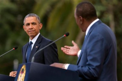 President Barack Obama, left, listens as Kenyan President Uhuru Kenyatta speaks during a news conference at State House, on Saturday, July 25, 2015, in Nairobi, Kenya. Obama nudged African nations Saturday to treat gays and lesbians equally under the law, a position that remains unpopular through much of the continent.  (AP Photo/Evan Vucci)